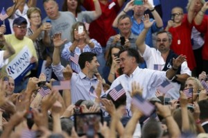 Smiling Romney and Ryan in the middle of a crowd only have eyes for each other