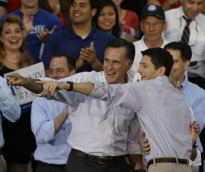 Romney and Ryan, each with arm around other, point with glee.